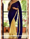 Magnetic Cream And Blue Net Designer Saree