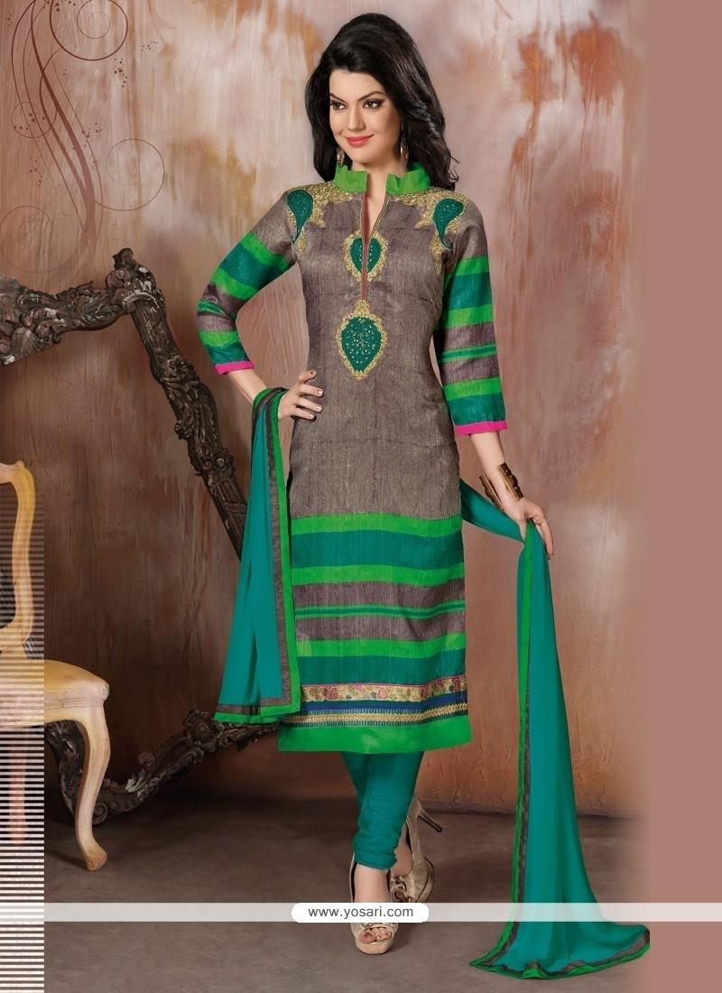 Aristocratic Raw Silk Green Churidar Designer Suit