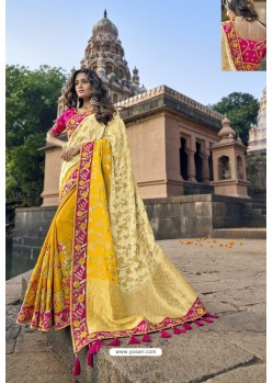 Cream And Yellow Silk Heavy Embroidered Wedding Saree