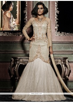 Flamboyant Net Brasso Cream And Off White Designer Lehenga Choli
