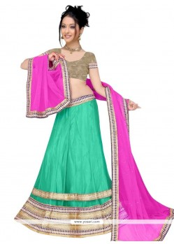 Exotic Net Pink And Sea Green Patch Border Work A Line Lehenga Choli