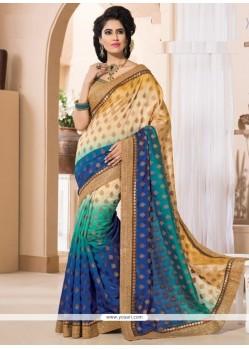 Astonishing Shimmer Georgette Zari Work Designer Saree