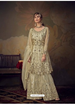 Cream Heavy Designer Wedding Wear Net Sharara Suit
