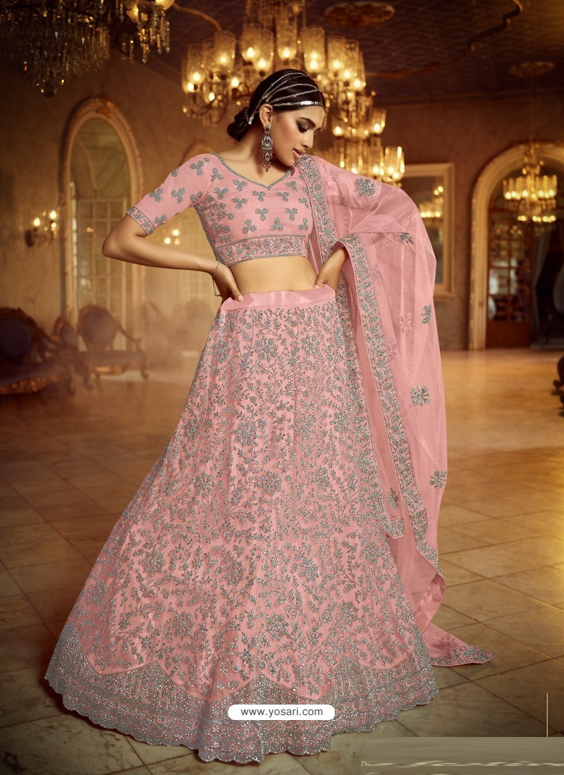 Pink Heavy Embroidered Designer Soft Net Wedding Lehenga Choli