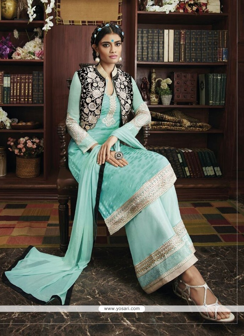 Pristine Embroidered Work Turquoise Georgette Designer Suit