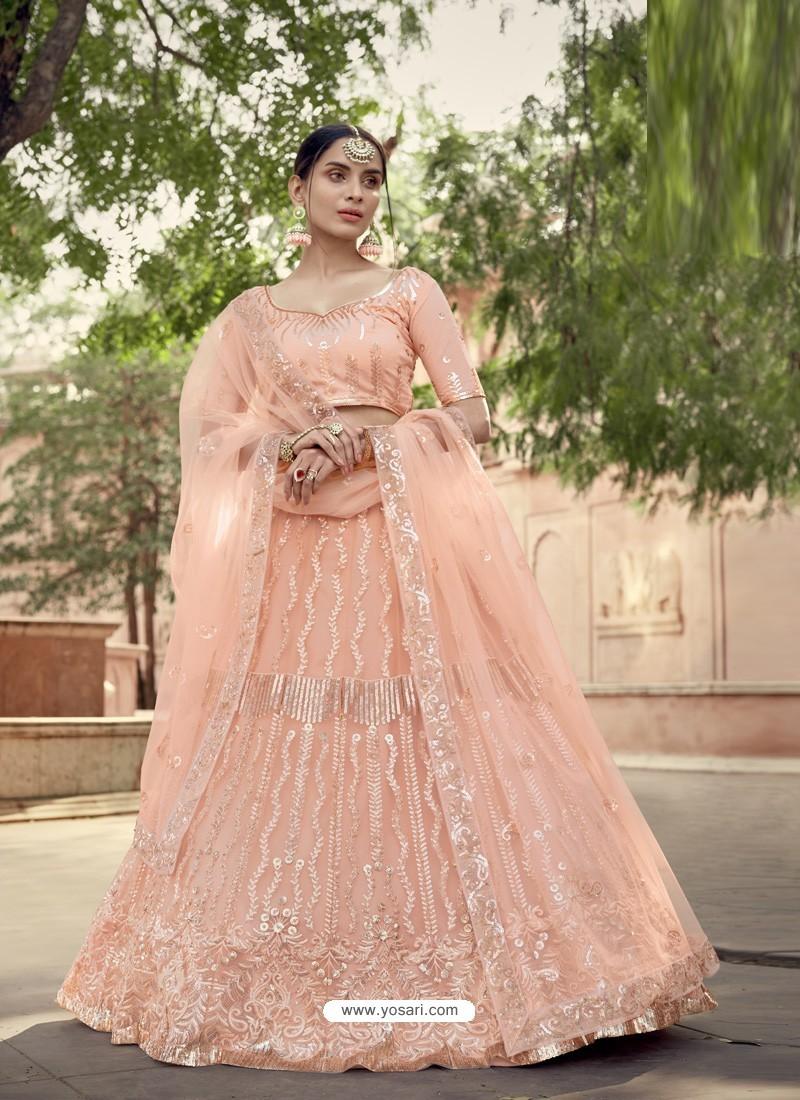 Light Orange Scintillating Designer Heavy Wedding Wear Lehenga
