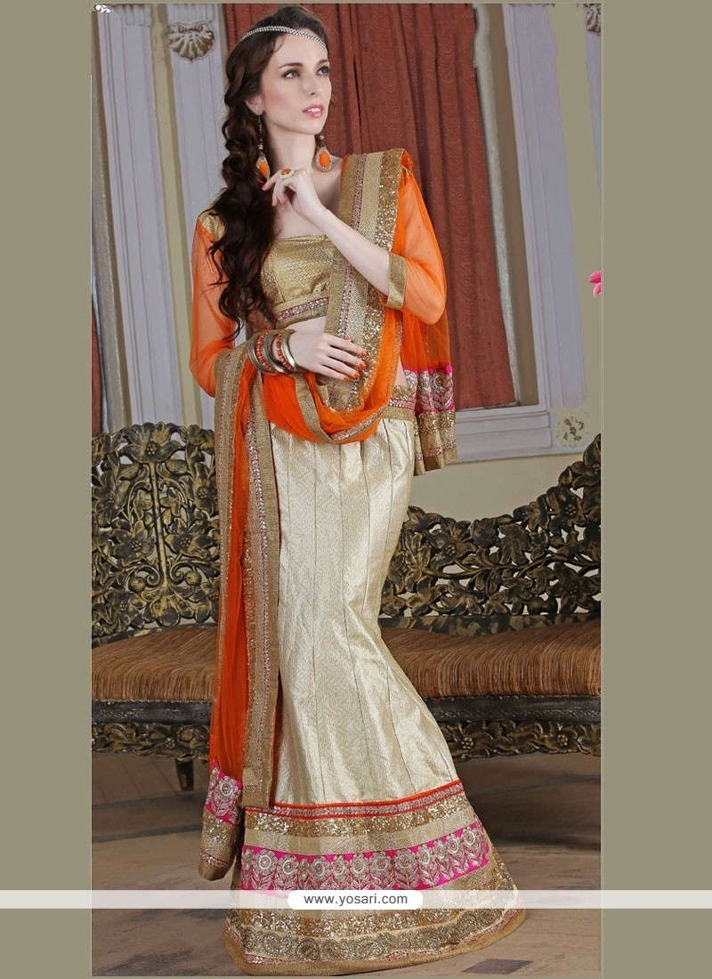Cherubic Beige And Orange Sequins Work Brocade A Line Lehenga Choli
