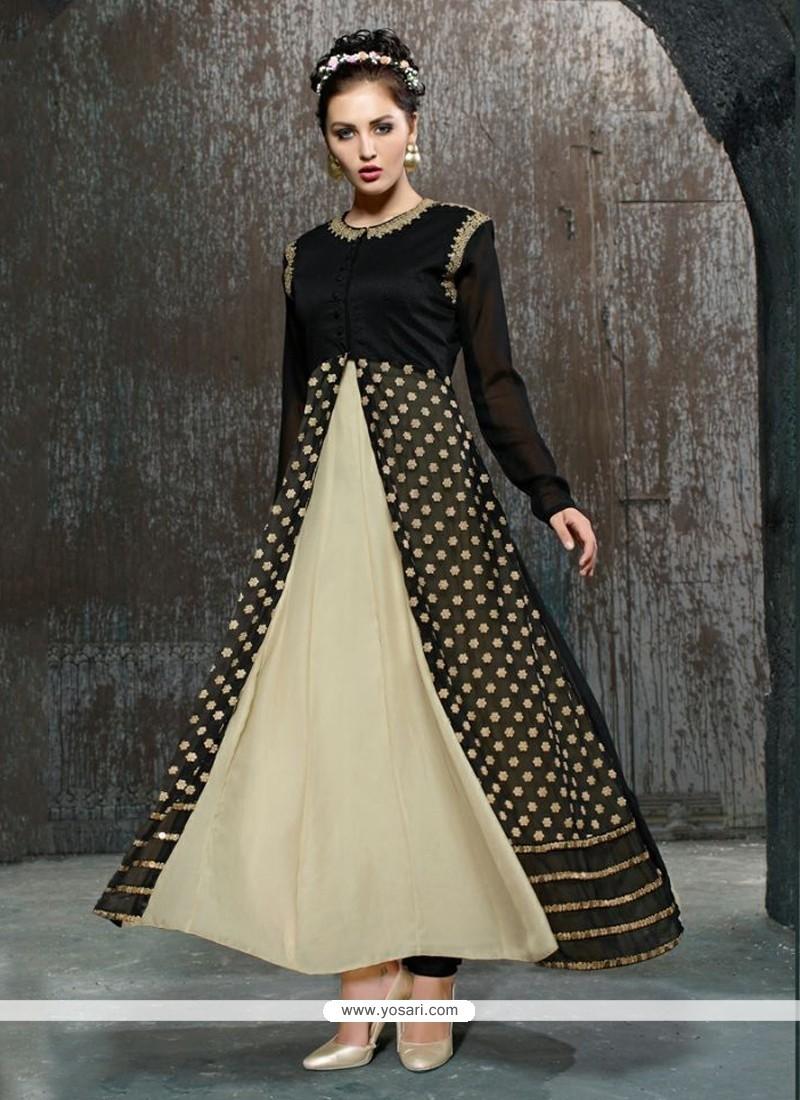 Adorning Black And Cream Net Anarkali Salwar Kameez
