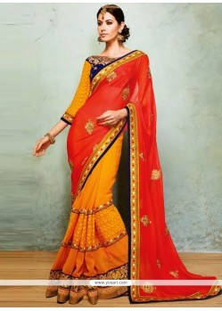 Markable Orange And Red Faux Georgette Saree